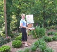photo of Jane painting outside. This space is 180 pixels square